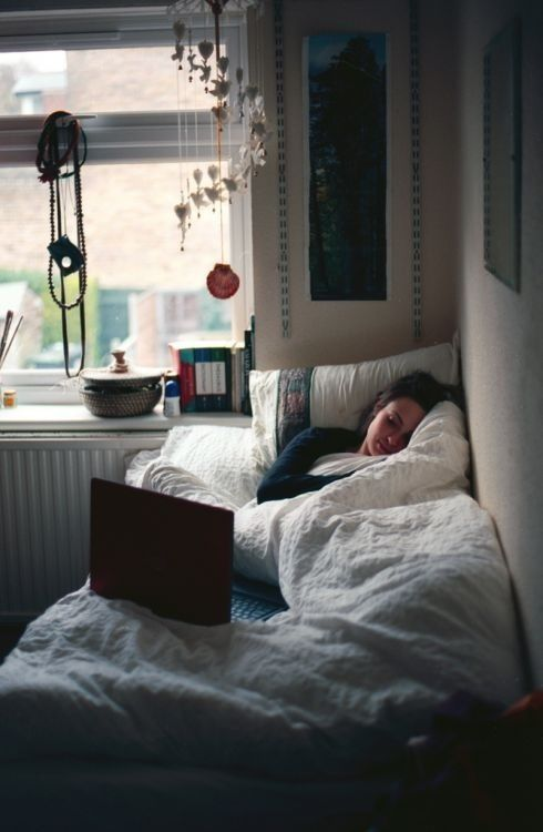 Love the bed in a cozy corner by the window