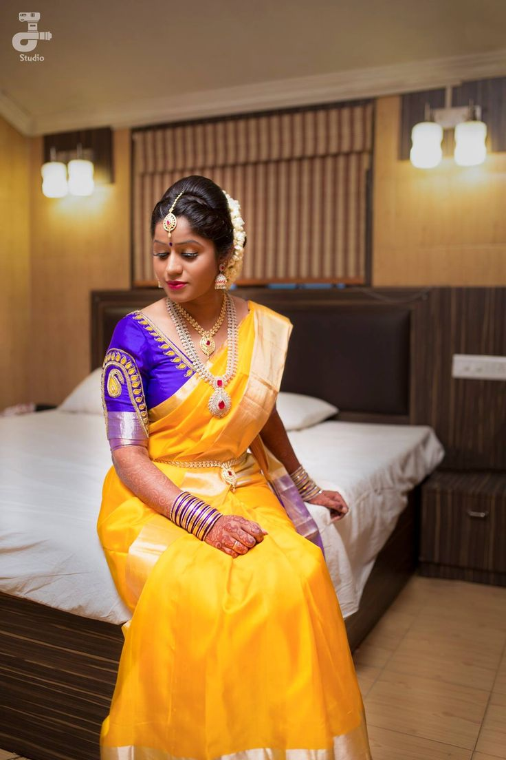 South Indian bride. Gold Indian bridal jewelry.Temple jewelry. Jhumkis. Yellow silk kanchipuram sari with contrast purple blouse.Braid with fresh jasmine flowers. Tamil bride. Telugu bride. Kannada bride. Hindu bride. Malayalee bride.Kerala bride.South Indian wedding.