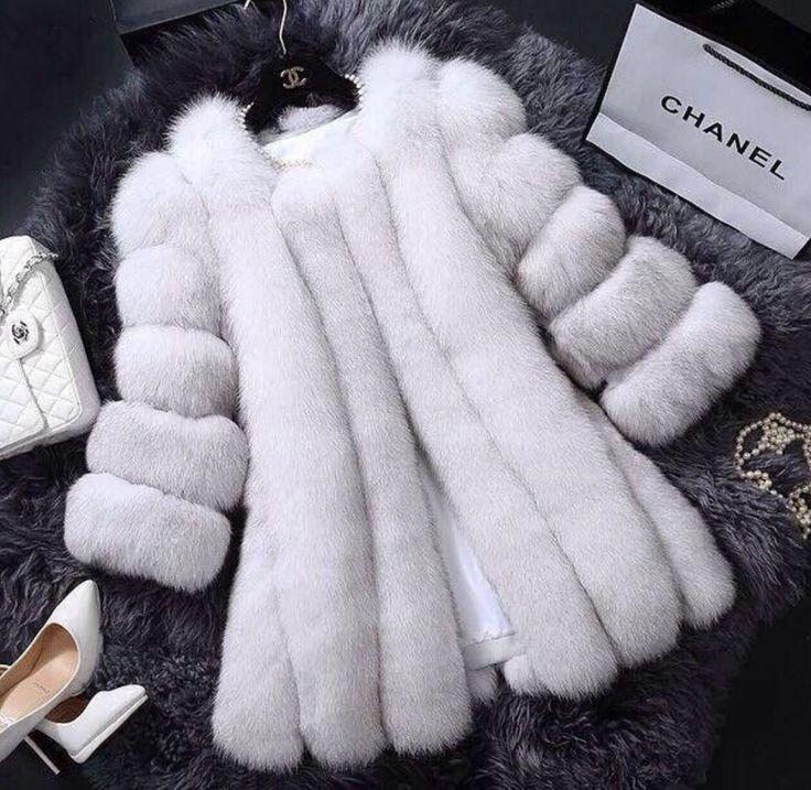 White fur, white heels, white bag, white pearls...you know what girls? Chanel in white xoxo