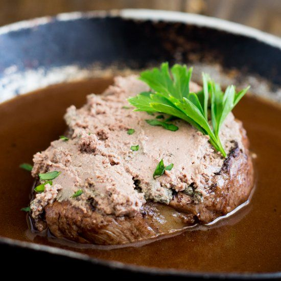 An elegant dinner party idea. Perfectly cooked fillet steak, topped with rich pâté served with a delicious red wine jus.