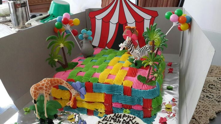 Madagascar Three. Children Theme Square Cake. 20x20cm square Birthday Cake. Eggless Chocolate Cake Frosted in Pure Buttercream stitches pattern. Bright and Colourful.