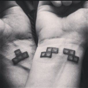 These sweet tetris pieces for the gaming duo. | 43 Adorable Couples' Tattoos That Will Stand The Test Of Time