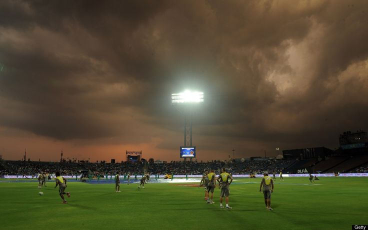 Dark rainclouds loom before a heavy downpour at The Subroto Roy Sahara Stadium in Pune.