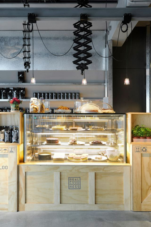 Bakery Café / Coffee Shop Design. Love the idea of covering the bottom of the cases with wood to make them cohesive.