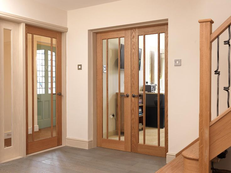 Beautiful oak glazed doors bring light into this home's hallway. JB Kind's  River Oak Darwen