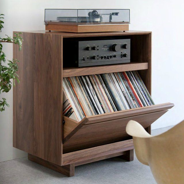 "An innovative and stylish storage unit, designed to house your LP collection.  Constructed from solid wood and offers one record storage bin and one shelf. Sized just right, the top surface and shelf of this compact cabinet provide plenty of surface space for a turntable and an audio component. The LP storage bin offers Symbol Audio's signature hinge system which swivels and allows the bin to open completely, while keeping the cabinet stable and level. Walnut Wood 29.75""W X 18""D X 34.75""H…"