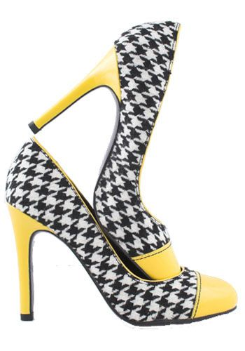 Photo of high heel shoes with yellow toe and heel, and a black-white checker design; taxi heels