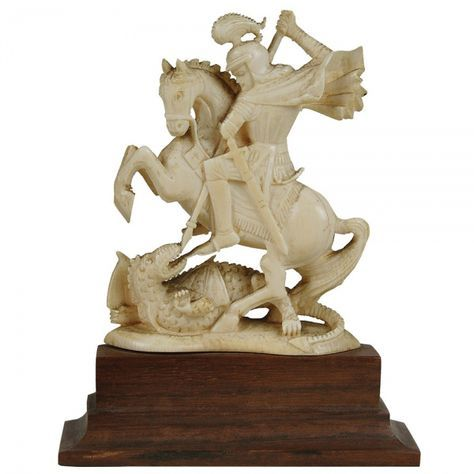 SÃO JORGE Imagem em marfim representando de São Jorge Guerreiro montado em seu cavalo em luta