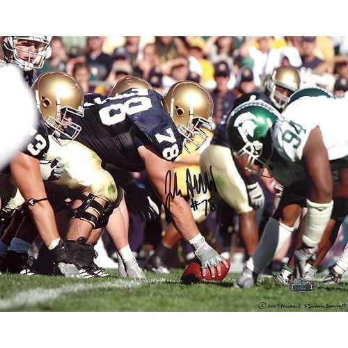 John Sullivan Over Center vs. Michigan State 11x14 Photo - John Sullivan of the Notre Dame Fighting Irish was the most experienced offensive player on the Irish roster in 2007. A center he was a rock of stability on whom the young team could rely and football fans everywhere agree that he can offer the same stability to a NFL roster in the very near future. John Sullivan has hand signed this 11x14 photograph of him over center during a game against Michigan State. A Steiner Sports…