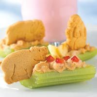 Safari Celery Sticks. This is a yummier, cuter version of the classic ants on a log. The filling is cream cheese, peanut butter and honey... and the animal crackers make it adorable!