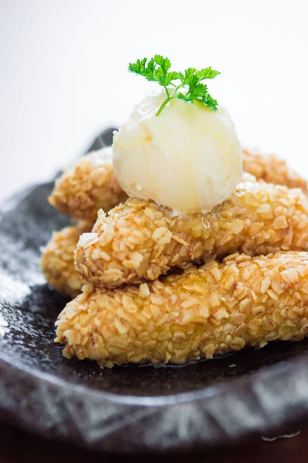 Fried bananas coated in a crispy oat crust and drizzled with honey. A delicious simple dessert.