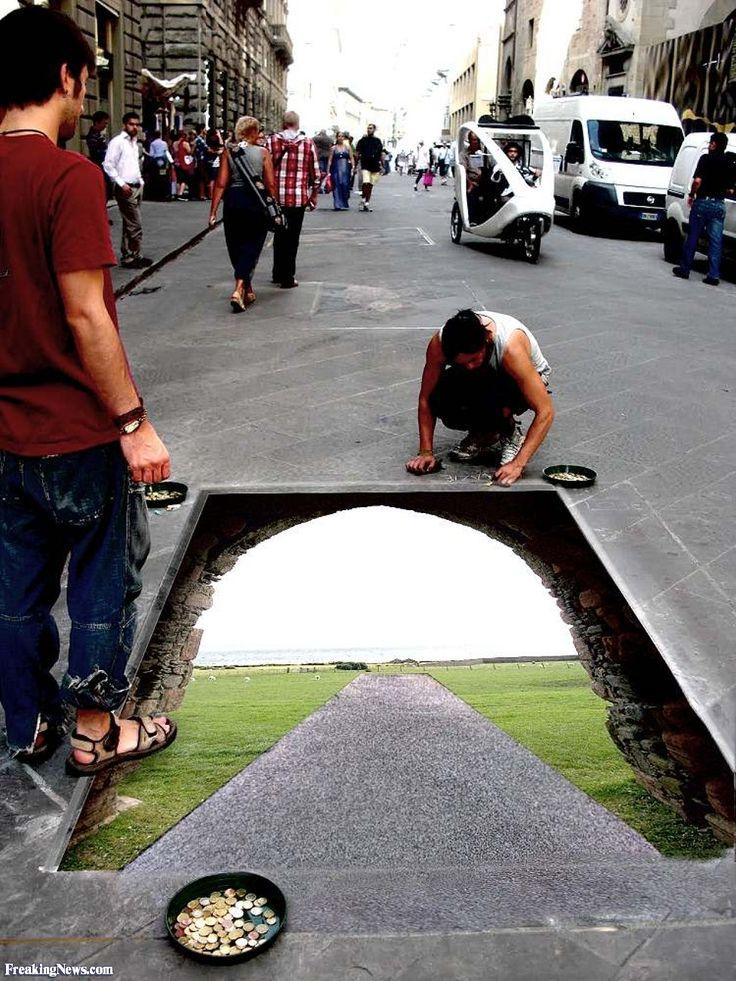 Man Drawing a Stone Gate on the Sidewalk