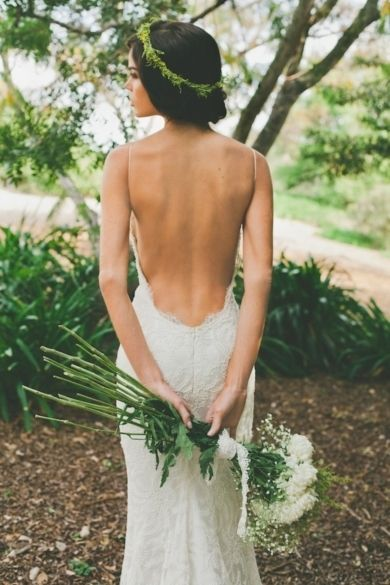 We love this daring, back-bearing dress teamed with a simple foliage crown. Photo by  Nicole L. Hill Photography on Bridal Musings