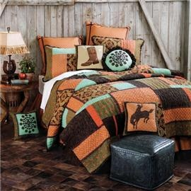 Great turquoise, orange and brown bedding. I dig it.