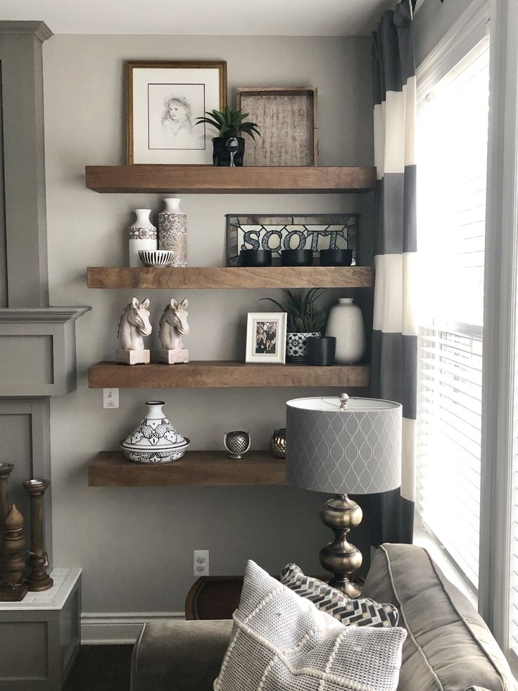 Wood floating shelves next to gray mantle. Joanna Gaines ...