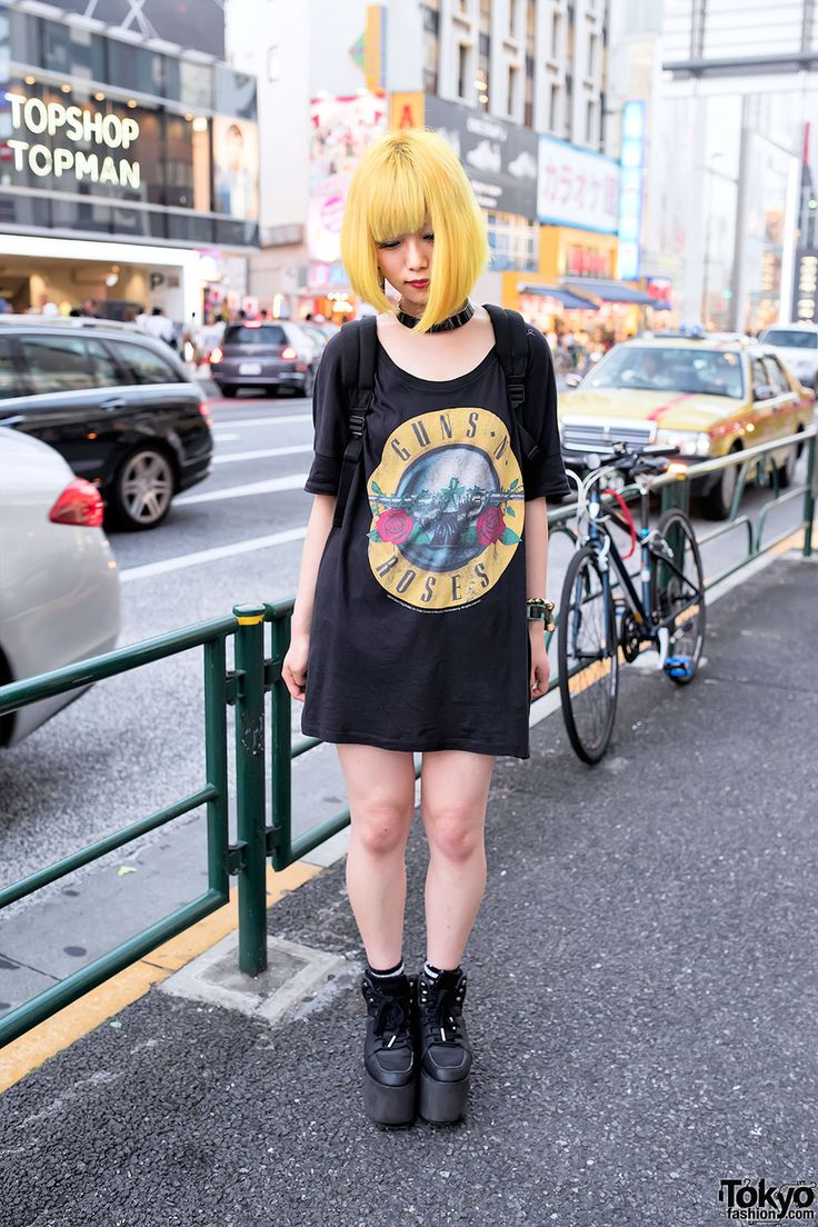 Murakami's yellow bob hairstyle caught our eye on Meiji Street in Harajuku.  Her look features an N' t-shirt dress, a x watch, and platform shoes.