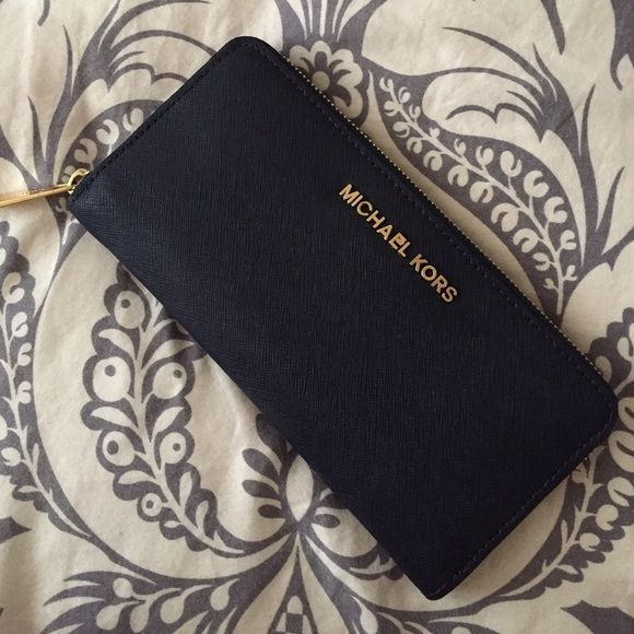 Authentic MK Wallet Large navy blue wallet. 8 card slots, 4 different compartments and 1 zipper area. No stains! I have matching Hamilton bag. Excellent condition!!! Michael Kors Bags Wallets