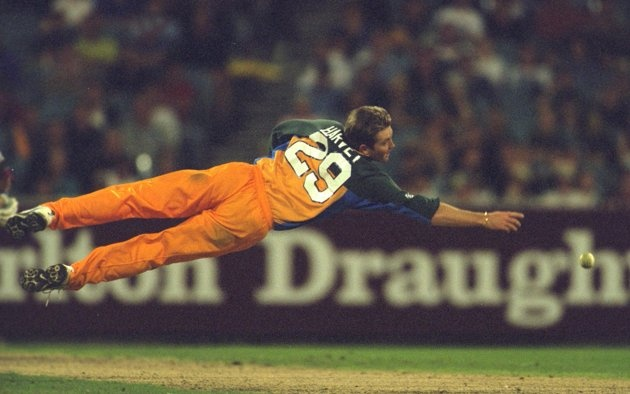 Ian Harvey of Australia dives for a catch in the second Final of the Carlton One Day International Series