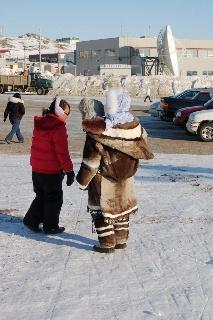Inuit Mother carring her baby,  Iqaluit, Nunavut. Canada!