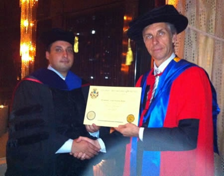 Mohammed Salah Hussien Basha receiving the degree from Prof. William Martin in Egypt.