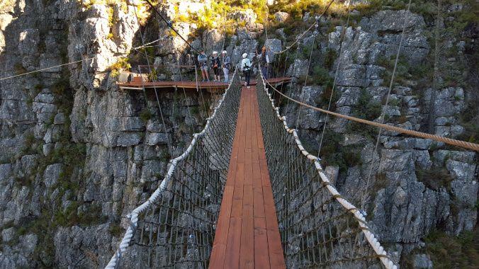 Lauren makes her way across the swing bridge.