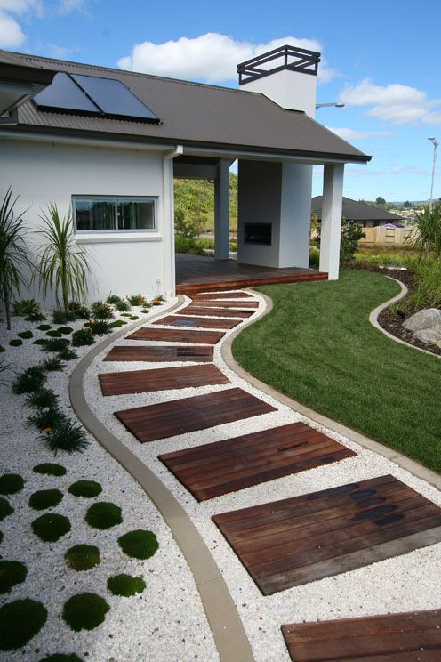 Wind your way round to the outdoor fireplace with covered decking. For year-round outdoor living!