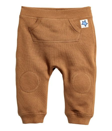 Sweatpants in a cotton blend with an elasticized waistband, kangaroo pocket at front, and ribbed hems. Soft, brushed inside. - Visit hm.com to see more. Size: 1.5-2yo