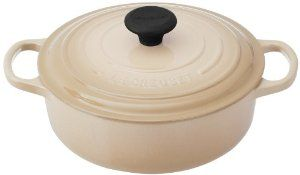 Le Creuset Signature Round Wide 3-1/2-Quart Dutch Oven, White - $149.95  You can probably find a good deal at the Le Creuset Outlet Store.