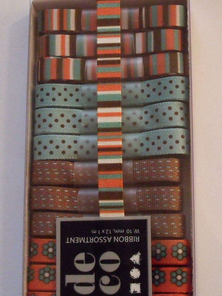 WOODWARE RIBBON COLLECTION - ORANGE BROWN AQUA -      Box of orange, brown and aqua coloured ribbons with 12 m of ribbon in 1m lengths. 3 of each of the 4 designs.