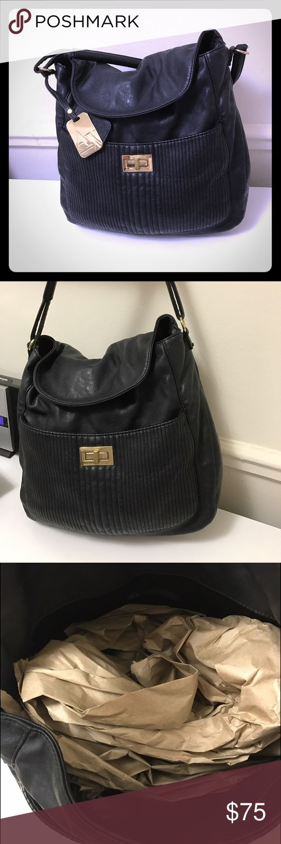 Armani Exchange tote hobo shoulder bag *Black Armani exchange black and gold hardware hobo bag. Large. Perfect for school/work. Fits large laptop. Great condition. Retails $129. Shoulder strap A/X Armani Exchange Bags Totes