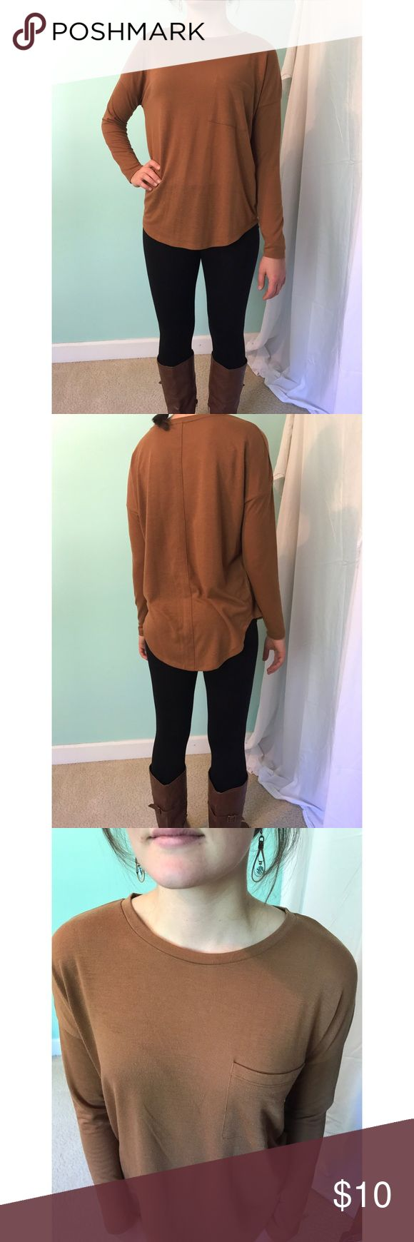 Honey brown long sleeve top! Long sleeve, warm honey brown top with front pocket! Perfect for fall. Only worn twice, great condition. 77% polyester, 19% rayon, 5% spandex. Old Navy Tops Tees - Long Sleeve