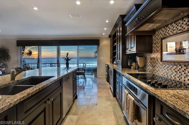 Renovated kitchen with an ocean view.  Renovated Beach Condo | Mansion House | Coquina Sands | Naples, Florida