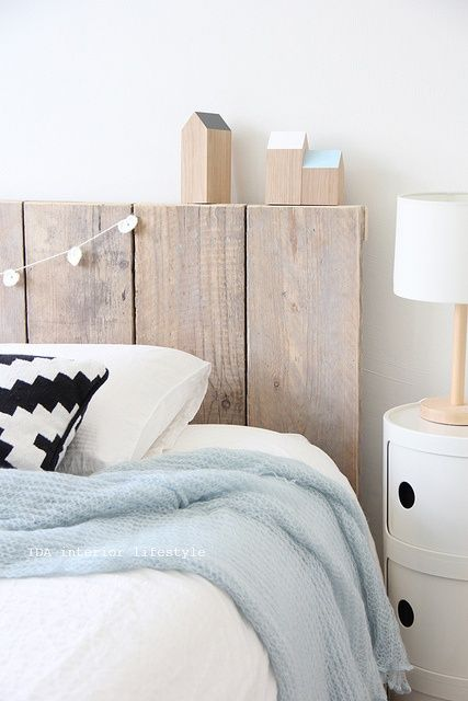 From Nordic Feeling Blog - lovely. Take a look at www.naturalbedcompany.co.uk for white bedding, pale blue throws and timber beds!