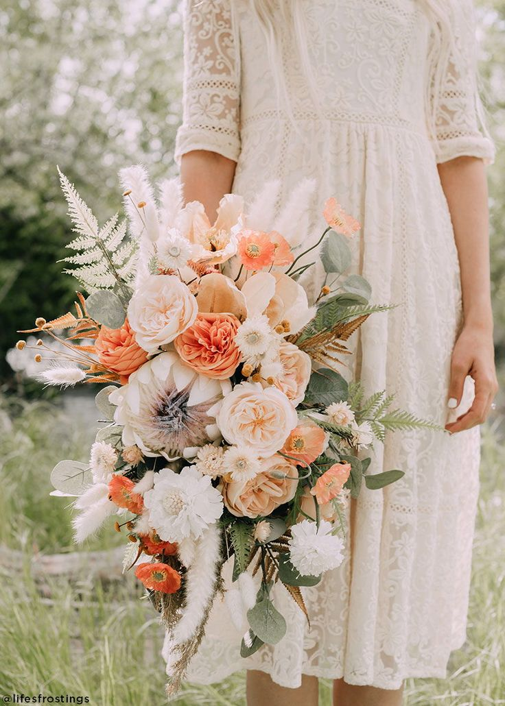 Fake Flower Wedding Bouquet in Orange and Coral Hues for Summer Brides.
