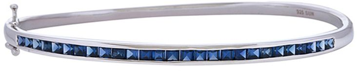 Diamond Addiction Sterling Silver Created Blue Sapphire Bangle. Bracelet dimensions: 4 mm wide X 66 mm long X 3 mm deep. Gemstone shapes: square. Stone: Gemstone. Finish: High polish. This fashionable bangle features 27 created white sapphire stones and is beautifully set in sterling silver.