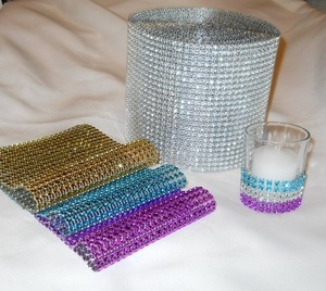 For Lisa's wedding we are using this to wrap her bouquet and to decorate the votive candles we are using.
