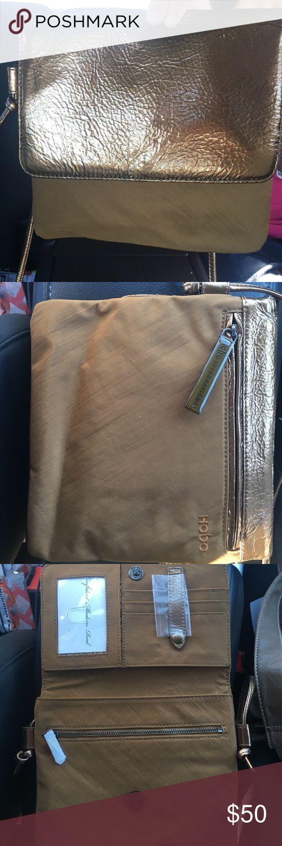 "HOBO International cross body purse!! Nylon Gold HOBO cross body purse! So cute! Perfect condition, great price☺️ 7""x7"" HOBO Bags Crossbody Bags"
