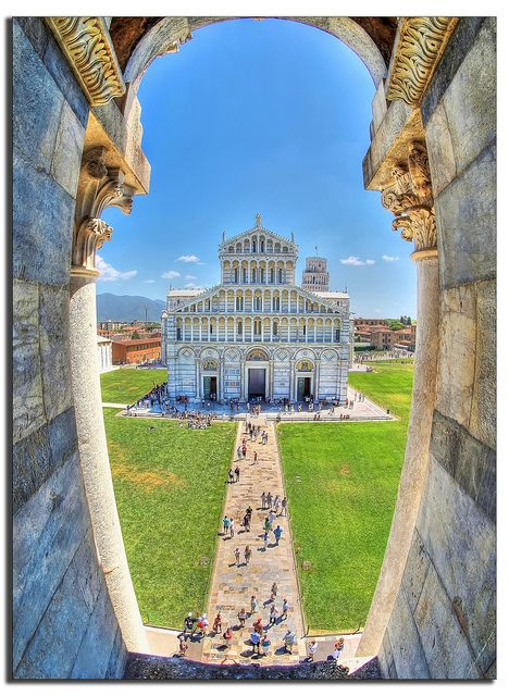 """Piazza dei Miracoli    The Piazza del Duomo (""""Cathedral Square"""") is a wide, walled area at the heart of the city of Pisa, Tuscany, Italy, recognized as one of the main centers for medieval art in the world. Partly paved and partly grassed, it is dominated by four great religious edifices: the Duomo (cathedral), the Campanile (the cathedral's free standing bell tower), the Baptistry and the Camposanto."""