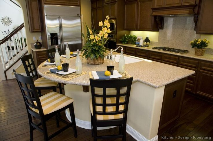 #Kitchen Idea of the Day: Classic Dark Walnut-Colored Kitchen with semi-circle island with seating.