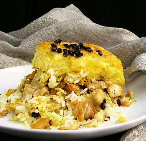 Persian Layered Chicken with rice, onions and yogurt, served with garlicky yogurt sauce. This casserole makes a spectacular presentation - great for special occasions or a fun family dinner.
