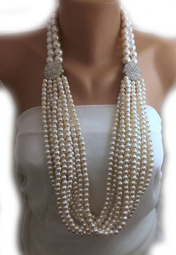 Red Carpet Jewelry! Multi Strands Ivory Pearls ! Amazing combination different size of pearls! Layered Pearl Necklace with Crystal Clasp. Both Crystal brooches are magnetic clasp. You can wear the necklace 3 or more different styles as you prefer You can find variations on