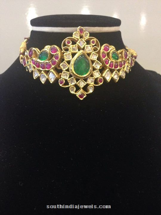 2-in-1 gold choker cum armlet design studded with rubies, emeralds and kundans. For inquiries please contact Sujala Gems & Jewels, 090007 32777. More CollectionsGold Mango Mala Choker NecklaceRuby Peacock ChokerGold Ruby Kundan Choker From Tibarumals JewellersLatest Gold Choker Design From Kalyan JewellersGold Antique Ruby Choker from Hiya Jewellery22k Gold Armlet Design from SwaastikGold Dandpatti DesignsGold
