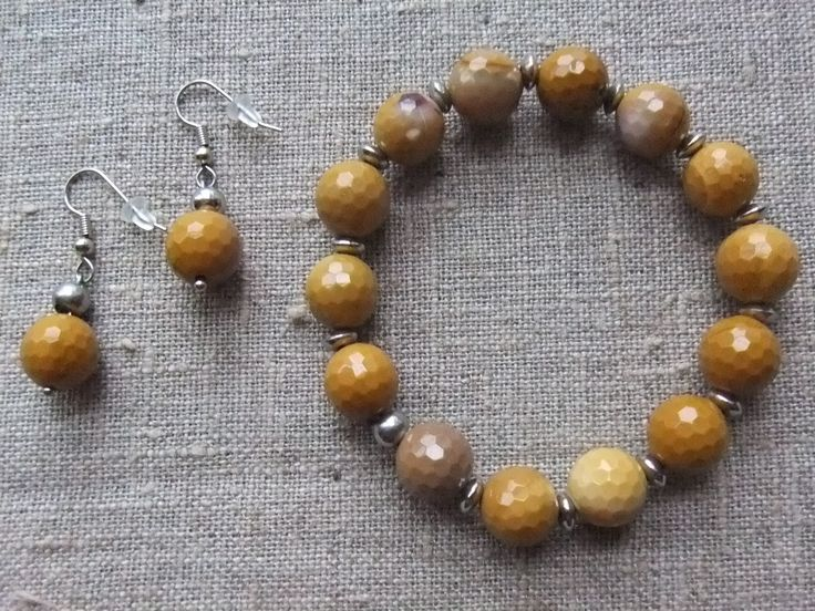 Bracelet / Armbånd. Curry coloured strech bracelet and earrings made of steel and gemstone. www.bulowssmykker55.amioamio.com