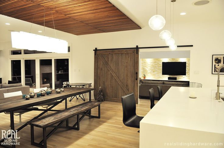 After a complete renovation, Real Sliding Hardware was used between the media room and main living area.