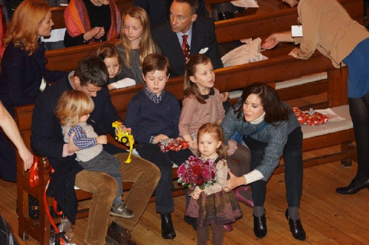Crown Prince Frederik, Crown Princess Mary and children, Prince Christian, Princess Isabella, Prince Vincent and Princess Josephine at the annual Christmas concert in The Esajas church in Copenhagen