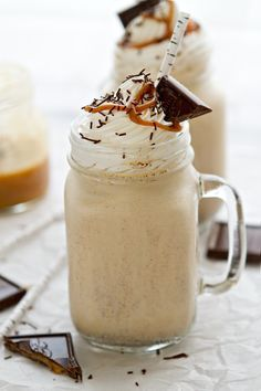 Salted Caramel Milkshake - Salted Caramel Milkshakes made with vanilla bean ice cream, salted caramel sauce and dark salted caramel chocolate. They're the perfect way to chill out and indulge!