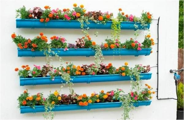 Gutter Gardens are becoming popular for growing lettuce and other vegetables in a small amount of space, but there's no reason they can't be decorative too! These painted gutters filled with annuals are fun and eyecatching.