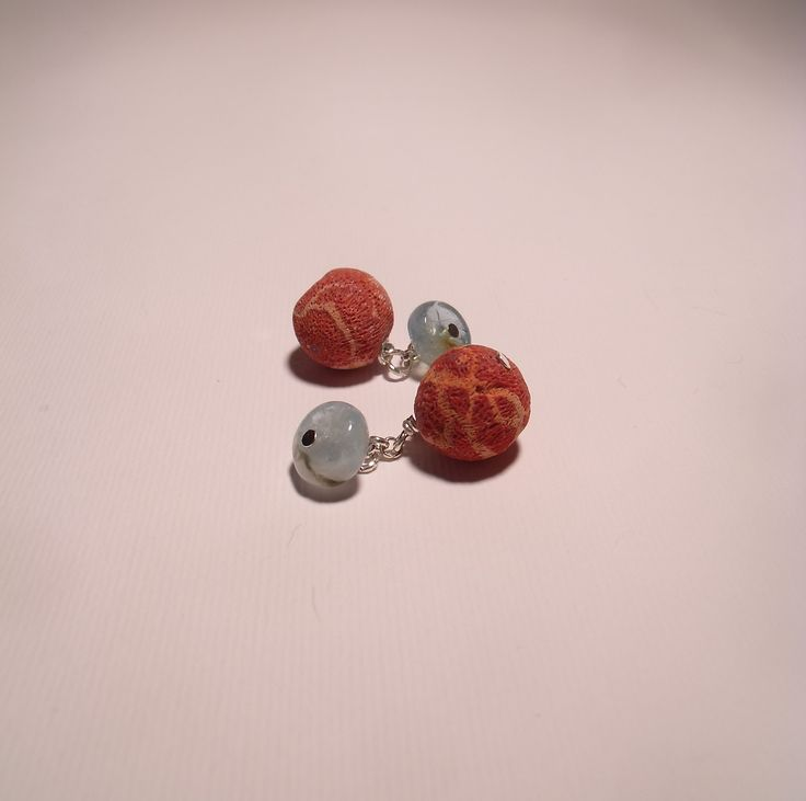 Cufflinks with rough coral and round smooth aquamarine