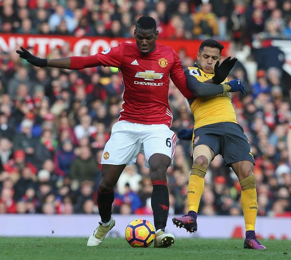 Paul Pogba of Manchester United in action with Alexis Sanchez of Arsenal during the Premier League match between Manchester United and Arsenal at Old...