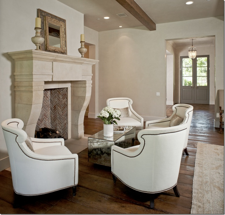Amazing Living Room With White Nailhead Trim Accent Chairs Surrounding Limestone Fireplace Herringbone Firebox Set Of Antique Mirrored Cube Tables